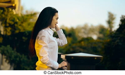 young stylish latin woman posing on a porch outdoors