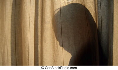Silhouette girl behind the curtain - Silhouette girl behind...