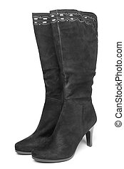 Black suede boots on white background