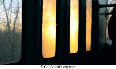 warm rays of sunset in the window of bus - warm rays of...