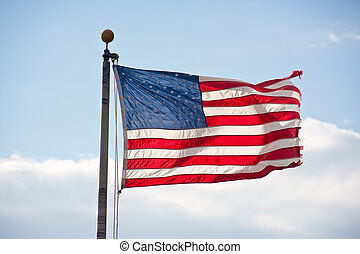 American Flag Backlit and Blowing in Wind.jpg