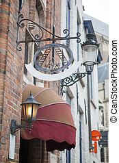 Sign saying Hotel in a Bruges street - sign saying Hotel in...