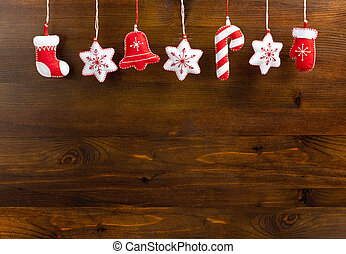 Hanging Christmas and New Year decorations on a wooden...