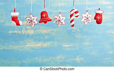 Hanging Christmas and New Year decorations on a blue wooden...
