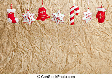 Hanging Christmas and New Year decorations on a craft paper...