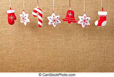 Hanging Christmas and New Year decorations on a burlap...
