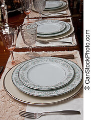 Rows of China Place Settings on Formal Table - A formal...