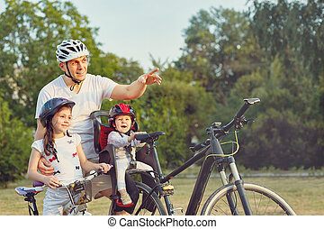 Family On Cycle Ride In Countryside - Family On Cycle Ride...