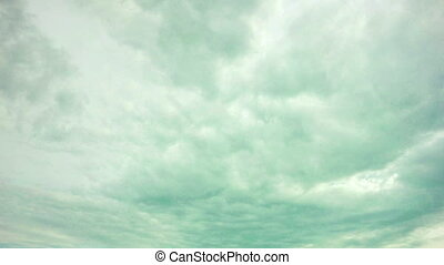 cloudy sky with heavy clouds, time laps, video loop - cloudy...