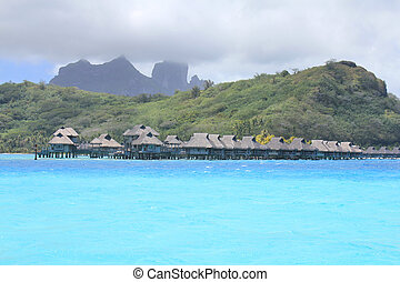 Bora Bora bungalows and mount Otemanu - Bora Bora water...