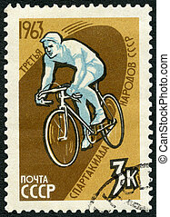USSR - CIRCA 1963: A stamp printed in USSR shows Bicyclist,...