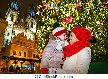 mother and child in Christmas Prague looking at each other