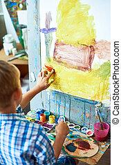Little Boy in Art Therapy - Back view portrait of little boy...