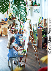 Young Artists - High angle portrait of three children...
