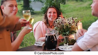 Girl is having dinner at the company of the guys - The girl...