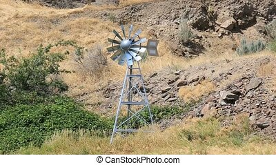 Video of moving windmill aerator structure in high desert in...