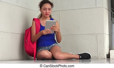 Confused Female Student With Tablet
