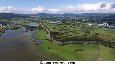 Flying along river and flooded fields. Ljubljanica on...