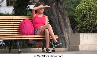 College Female Student Sitting On Park Bench