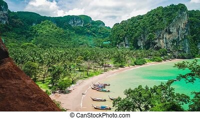 Hat Tom Sai Beach with long tail boats on the beach. Railay...