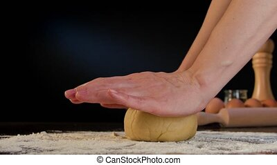 Female Hands Kneading Dough on the Table - Female hands...