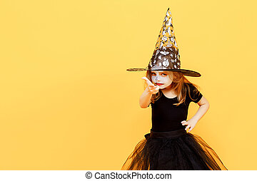 Girl in witch Halloween costume - Small girl in Halloween...