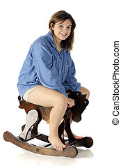 Rocking Horse Teen - A teen girl in an over-sized denim...