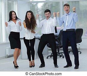 portrait of a triumphant business team - concept of...