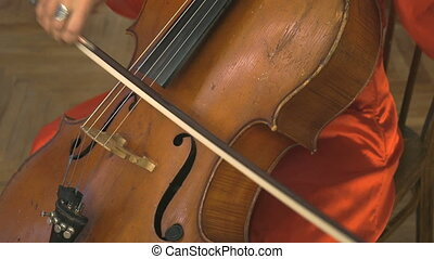 Woman playing the contrabass in the orchestra