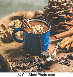 Rich winter hot chocolate with cinnamon and walnuts, square...