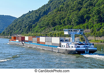 shipping container transported on river barge - cargo boxes...