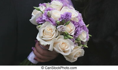 Close-up of beautiful wedding bouquet of roses - Close-up of...