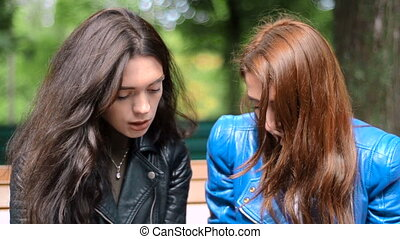 brunette tells the story of girlfriend in the Park - young...