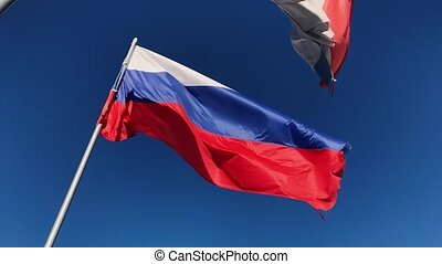Russian flag fluttering in the wind In slow motion