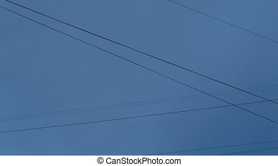 City wires against the cloudy sky background timelapse