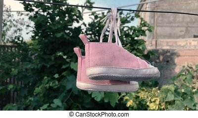 Baby sneakers on the wire