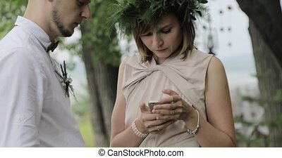 Woman shows something on phone to her boyfriend - A girl is...