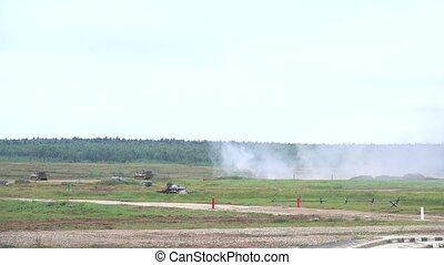 Slow motion shot of shooting Russian army self-propelled...