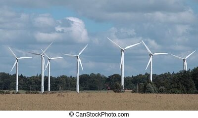 Wind turbines in summer day