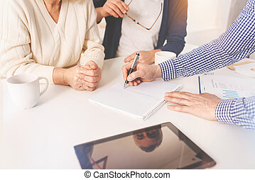 Pleasant aged couple meeting with real estate agent - Pros...