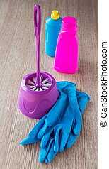 still life with a toilet brush and latex gloves