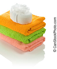 bath sponge on towels