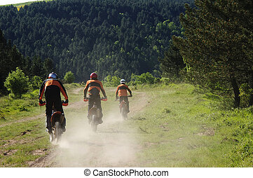 Motocross riders - Three enduro riders in nature