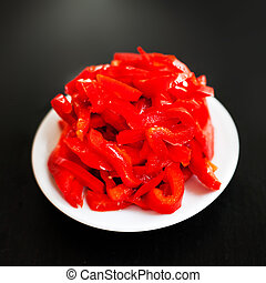 Canned vegetables - Marinated red pepper red peppers on a...