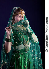 young woman look at you - close face with veil