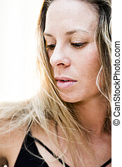 Portrait of the face of a beautiful blond woman on...