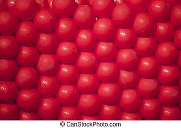 red balloons all equal placed together and stiched each...