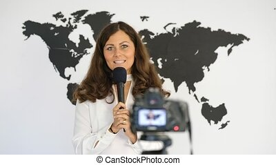 Journalist reporting from the studio on the background of...