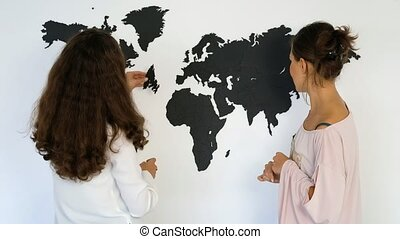 Couple is fixing the world map - Girls twins fixing the...