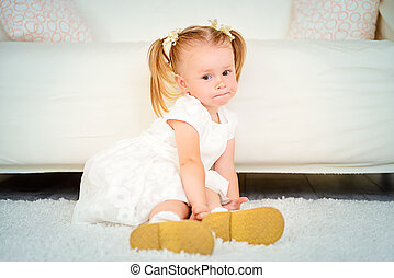 two year old girl - Cute two year old girl playing at home....